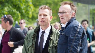 Spotted: Ewan McGregor and Danny Boyle on set outside the Scottish Parliament.