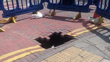 Sinkhole: The road could be closed for some time.