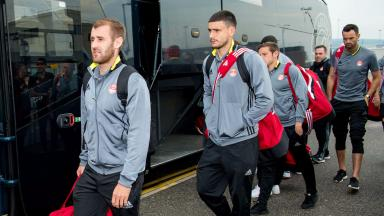 Aberdeen players board the bus back to Pittodrie.