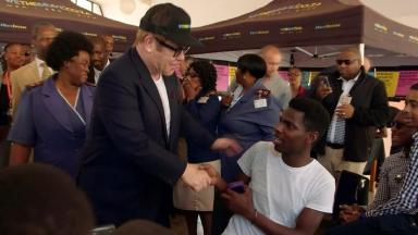 Sir Elton John meets delegates at a HIV conference in Durban.