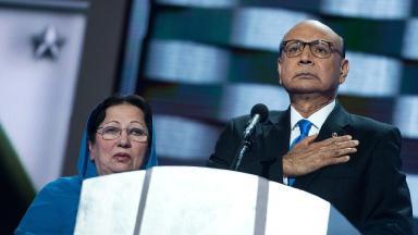 Ghazala Khan standing next to her husband Khizr Khan as he addresses the crowd at the DNC