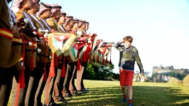 Preparations: Tosh Thomson, nine, inspects the Jordanian Royal Guard.