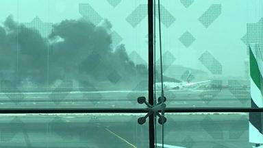 Smoke poured from the back of the Emirates flight after it crash landed.