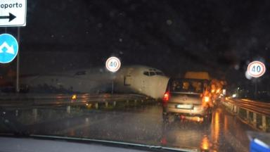 Drivers were astonished to see the plane wedged onto the road