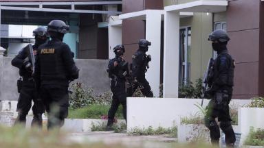 Indonesian anti-terror police during a raid in Batam