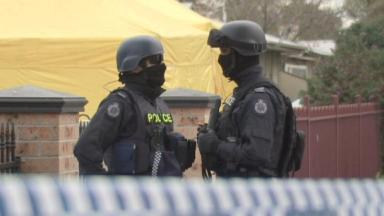 Armed police raided a property on Saturday.