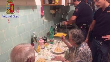 The couple tuck into their pasta.