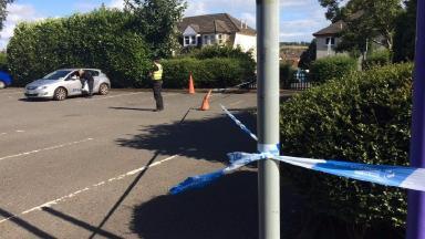 Barrhead: Police investigating the scene on Sunday.