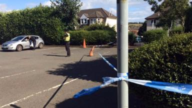 Investigation: Police near Asda store in Barrhead, East Renfrewshire.
