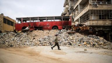 Child walks in the rubble of Aleppo.