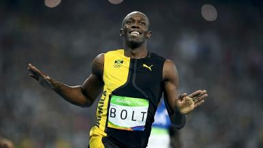 Usain Bolt celebrates after crossing the line.