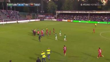 Match footage shows players and officials running to the keeper's aid.