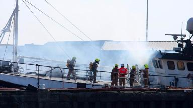Fishing trawler: Firefighters tackle blaze on vessel at Peterhead Harbour.
