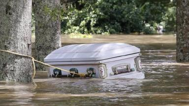 A casket is seen floating in flood waters in Ascension Parish, Louisiana.