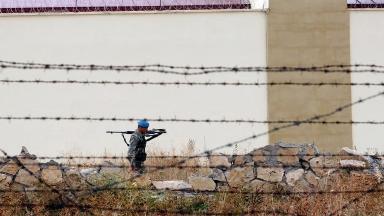 A guard patrols outside a Turkish prison in 2011