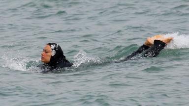 A woman wears a 'burkini' swimsuit in Marseille, France