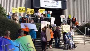 Protest: Service users demonstrate outside council HQ.