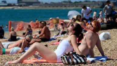 Sunbathers hit the beach in Portsmouth on July 19 as Britain enjoyed the hottest day of the year so far.