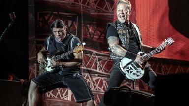 Robert Trujillo (left) and James Hetfield (right) of Metallica play Reading Festival in 2015.