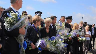 Many held floral tributes to lay on the Toll Bridge in Shoreham.