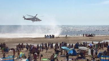 Helicopter rescue teams at Camber Sands Beach, where three swimmers died after being pulled from the water.