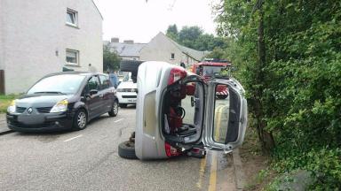 Car overturns: Incident in Spital Walk, Aberdeen.