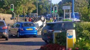Aberdeen: Car lands on roof after crash.