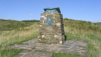 Targeted: The bronze book on top of the cairn has been stolen.