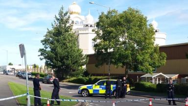 A police cordon is in place around the temple.