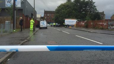Dalness Street: Police carry out investigations.