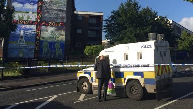 Cordon: Police at scene of shooting of John Boreland in Belfast.