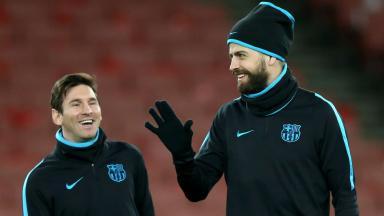 Lionel Messi and Gerard Pique in training