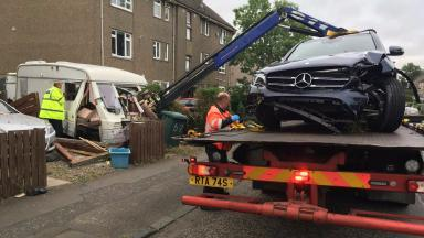 Collision: The Mercedes was recovered from the scene.