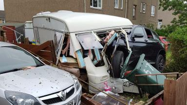Smash: The car collided with a parked caravan.