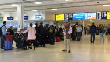 Airport: Passengers queuing on Thursday morning.