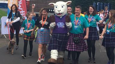 Kiltwalk: Lorraine Kelly and friends approach the finish line.