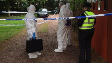 Investigation: Forensics officers combed the scene.