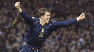 Rocking Hampden: Gary Caldwell celebrates his goal that sunk the French.