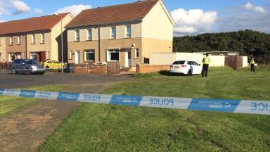 Cordon: Police at the scene of the attack.