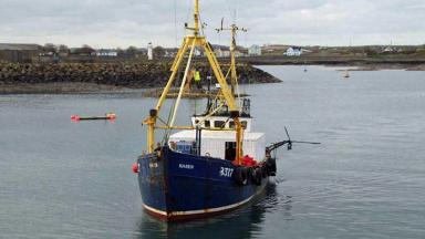 Karen: Damaged fishing trawler returning to port after the incident.