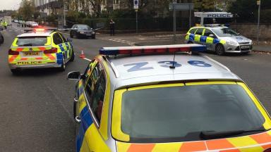 Crash: Police at scene on Dumbarton Road after boy hit by two cars.