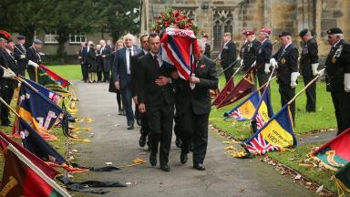 A guard of honour was performed outside the church