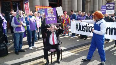 Picket: Striking janitors protest outside Glasgow city chambers.
