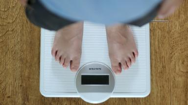Child on set of scales. Generic for child obesity/overweight stories. Image from PA