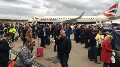 Evacuation: Hundreds of passengers were left on the tarmac.