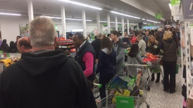 Customers queuing at Asda in Southgate after the card system problem.