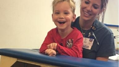 Louie Elbourne is now having physiotherapy to help him learn to walk