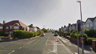 The officer was attacked with a knife on Westmoreland Avenue in Cleveleys.