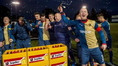 Record-breakers: East Kilbride celebrate with their prize.