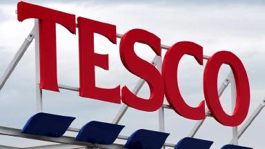 Tesco has cut the amount of sugar in its own brand soft drinks.